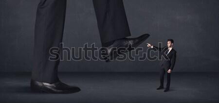 Enorme pierna minúsculo hombre fondo traje Foto stock © ra2studio