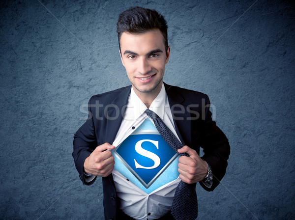 Businessman ripping off his shirt with superhero sign  Stock photo © ra2studio