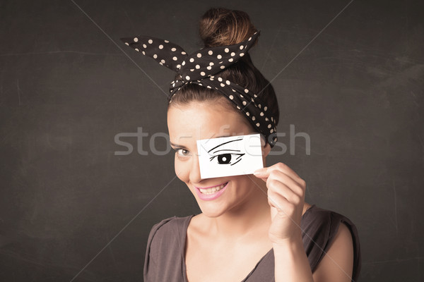 Stock photo: Silly youngster looking with hand drawn eye paper