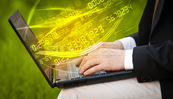 Man typing on modern notebook with number technology data coming Stock photo © ra2studio