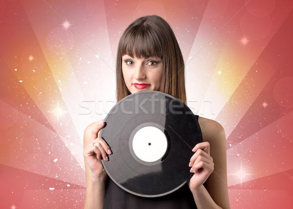 Dame vinyle record jeunes rouge Photo stock © ra2studio