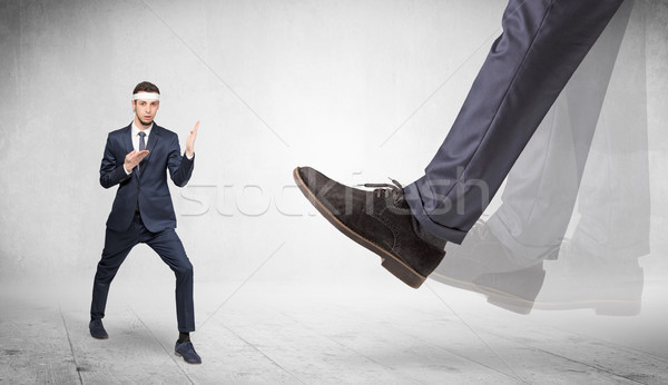 Big foot trample suited karate man Stock photo © ra2studio