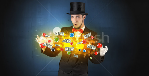 Illusionist conjure with his hand gambling staffs Stock photo © ra2studio
