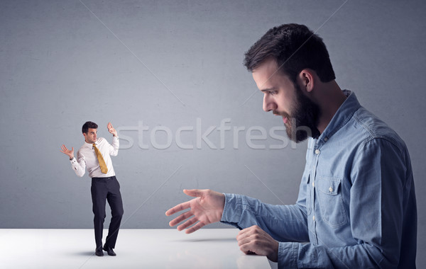 Jóvenes empresario miniatura profesional enojado Foto stock © ra2studio