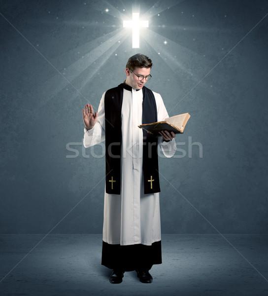 Fiatal pap áldás kaukázusi mély hit Stock fotó © ra2studio