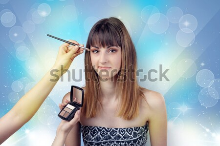 Graceful woman getting ready with shiny background Stock photo © ra2studio