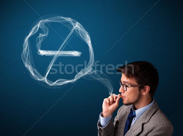 Moço fumador insalubre cigarro assinar Foto stock © ra2studio