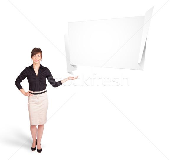 Fiatal nő bemutat absztrakt origami copy space izolált Stock fotó © ra2studio