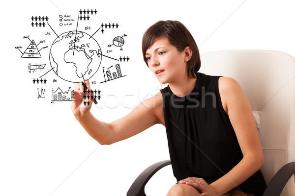 Jeune femme dessin monde diagrammes isolé blanche Photo stock © ra2studio