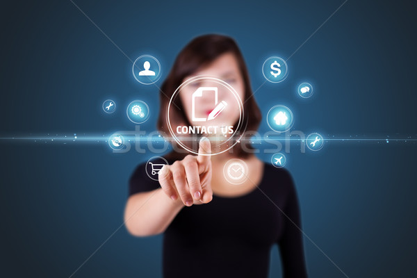 Businesswoman pressing virtual messaging type of icons Stock photo © ra2studio