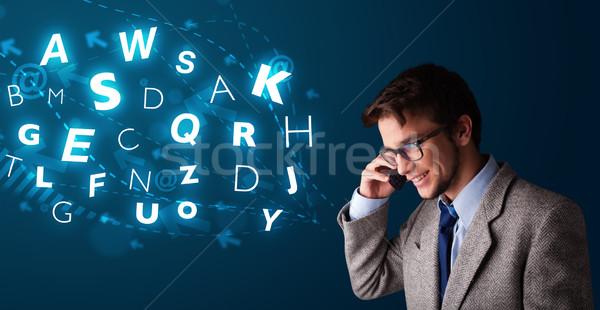 Young boy making phone call with shiny characters Stock photo © ra2studio