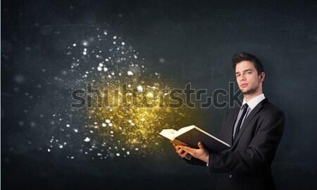 Young guy reading a magical book Stock photo © ra2studio