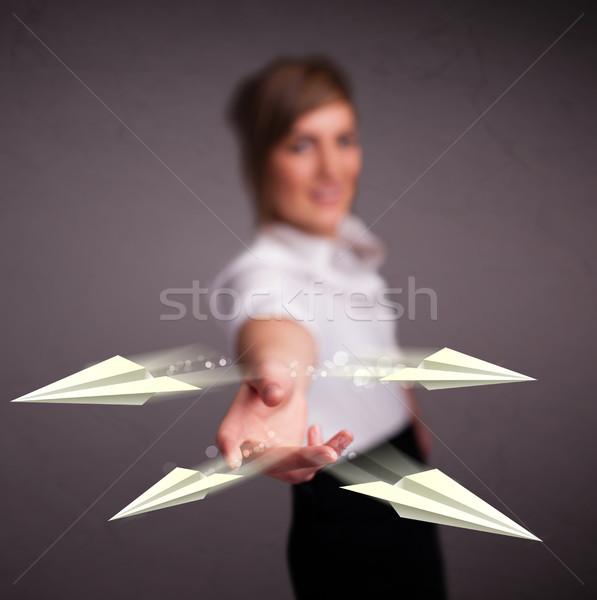 Gyönyörű hölgy dob origami repülőgépek fiatal Stock fotó © ra2studio