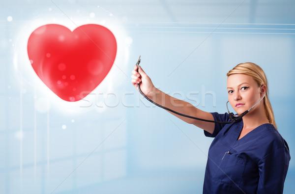 Giovani infermiera guarigione rosso cuore bella Foto d'archivio © ra2studio