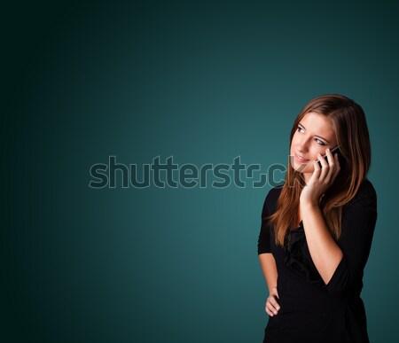 Fiatal nő készít telefonbeszélgetés copy space áll nő Stock fotó © ra2studio