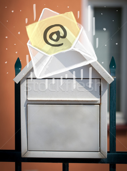 Envelope with email sign dropping into mailbox Stock photo © ra2studio