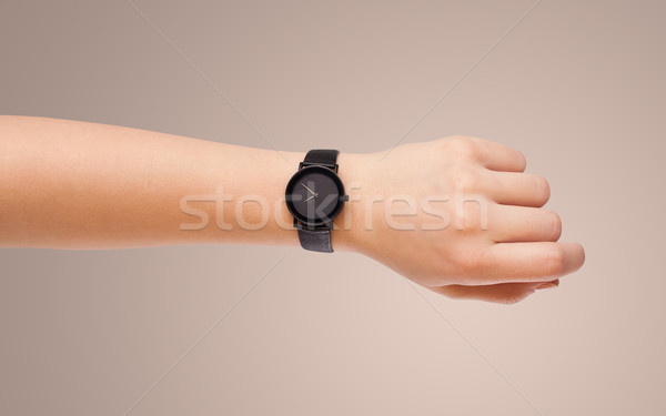 Hand with watch showing precise time Stock photo © ra2studio