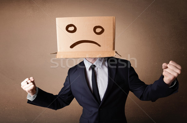 Businessman gesturing with cardboard box on his head with sad fa Stock photo © ra2studio