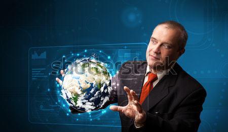 üzletember megérint 3D Föld panel áll Stock fotó © ra2studio