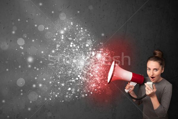 Nő kiált megafon izzó energia részecskék Stock fotó © ra2studio