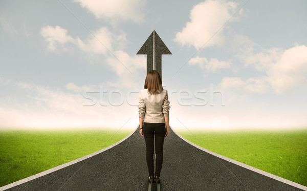 Business woman lokking at 3d road with up arrow Stock photo © ra2studio