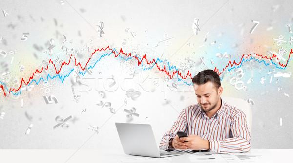 Homme d'affaires séance table bourse graphique 3D Photo stock © ra2studio