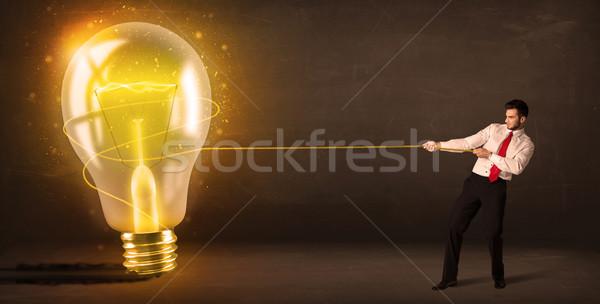 Hombre de negocios grande brillante bombilla Foto stock © ra2studio
