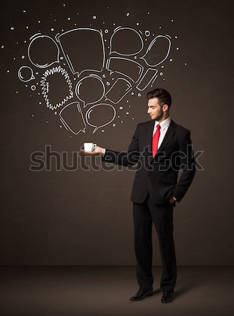 Businessman holding a white cup with lines and arrows Stock photo © ra2studio