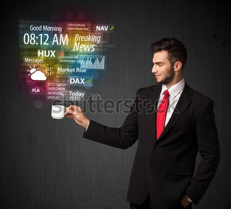 Businessman holding a white cup with daily news and information Stock photo © ra2studio