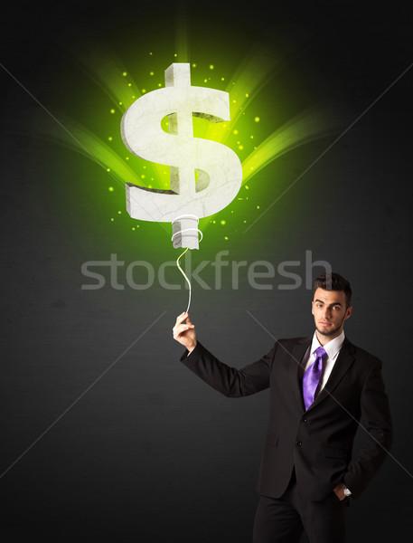 Stock fotó: üzletember · dollárjel · léggömb · tart · ragyogó · zöld