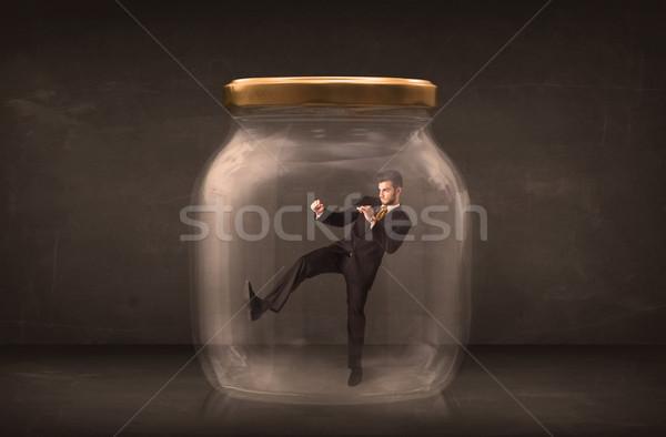 Businessman shut into a glass jar concept Stock photo © ra2studio