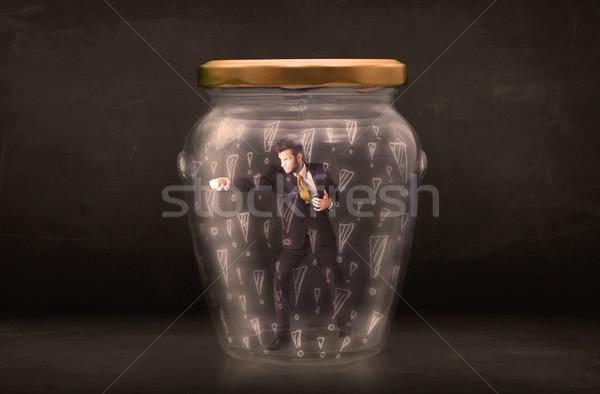 Om de afaceri prins borcan afaceri sticlă trist Imagine de stoc © ra2studio