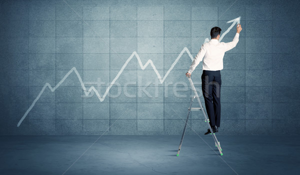 Stock photo: Man drawing line from ladder