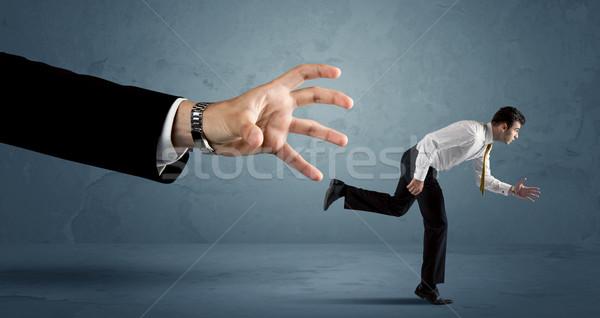 ビジネスマン を実行して 巨大な 手 作業 ストックフォト © ra2studio