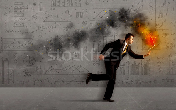 Running business man with fire laptop Stock photo © ra2studio