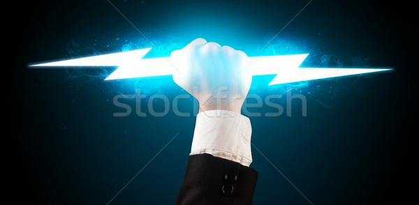 Geschäftsmann halten glühend Blitz Hände Feuer Stock foto © ra2studio
