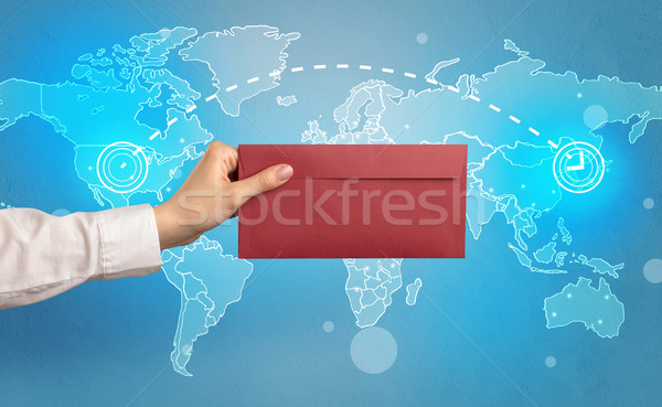 Hand holding envelope with global concept Stock photo © ra2studio