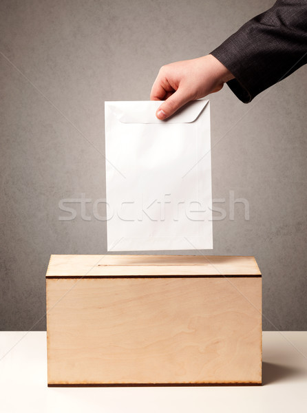 Ballot box with person casting vote  Stock photo © ra2studio