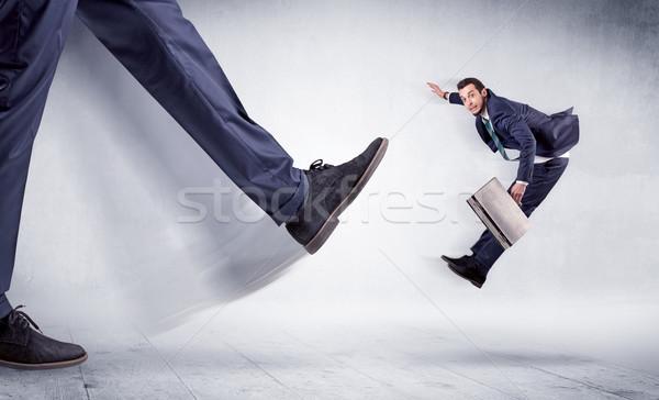 Nagy láb rúg kicsi férfi óriás Stock fotó © ra2studio