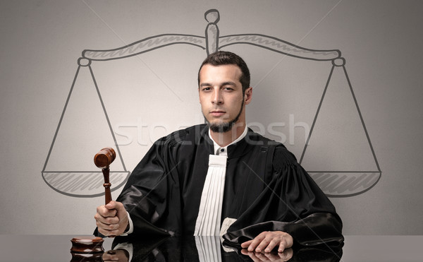 Young judge in gown deciding Stock photo © ra2studio