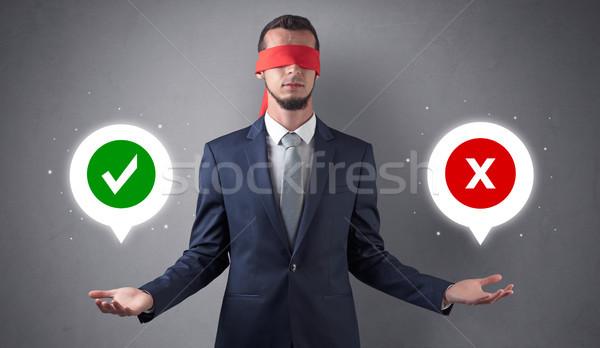 Blindfolded businessman trying to choose Stock photo © ra2studio