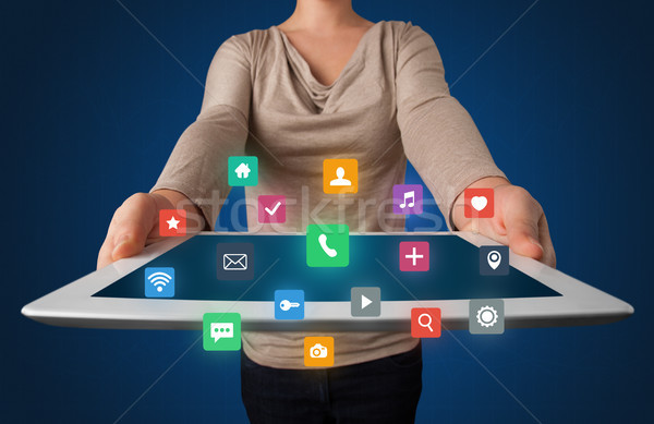 Woman holding tablet with multimedia graphics Stock photo © ra2studio