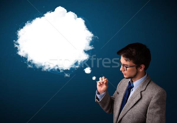 Fiatalember dohányzás egészségtelen cigaretta sűrű füst Stock fotó © ra2studio