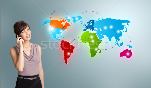 young woman making phone call with colorful world map Stock photo © ra2studio