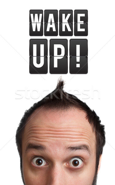 Stock photo: Funny Young man with wake up sign over head