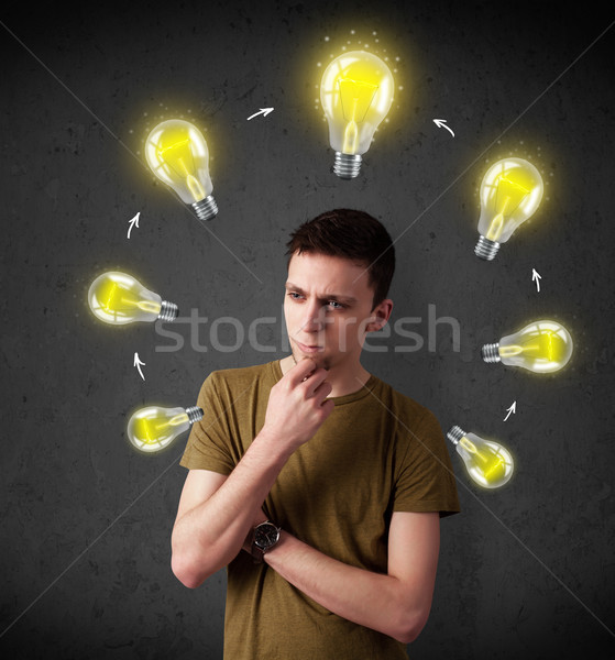 Young man thinking with lightbulb circulation around his head Stock photo © ra2studio