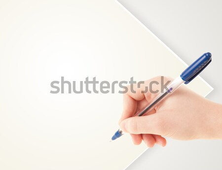Hand writing on plain empty white paper copy space Stock photo © ra2studio