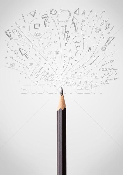 Pencil close-up with sketchy arrows Stock photo © ra2studio