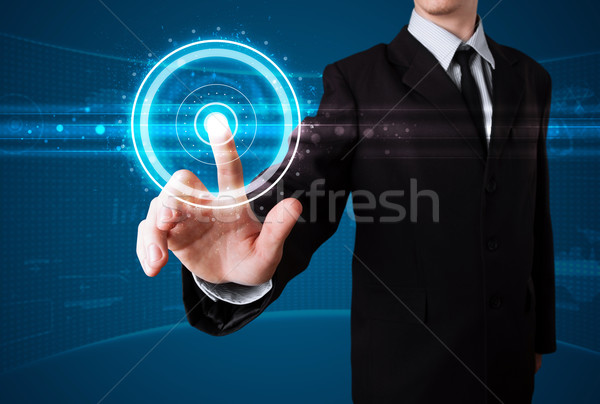 Businessman pressing high tech type of modern buttons  Stock photo © ra2studio