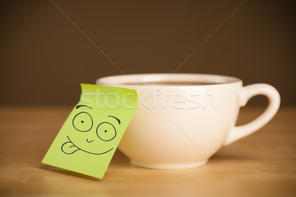 Post-it note with smiley face sticked on a cup Stock photo © ra2studio
